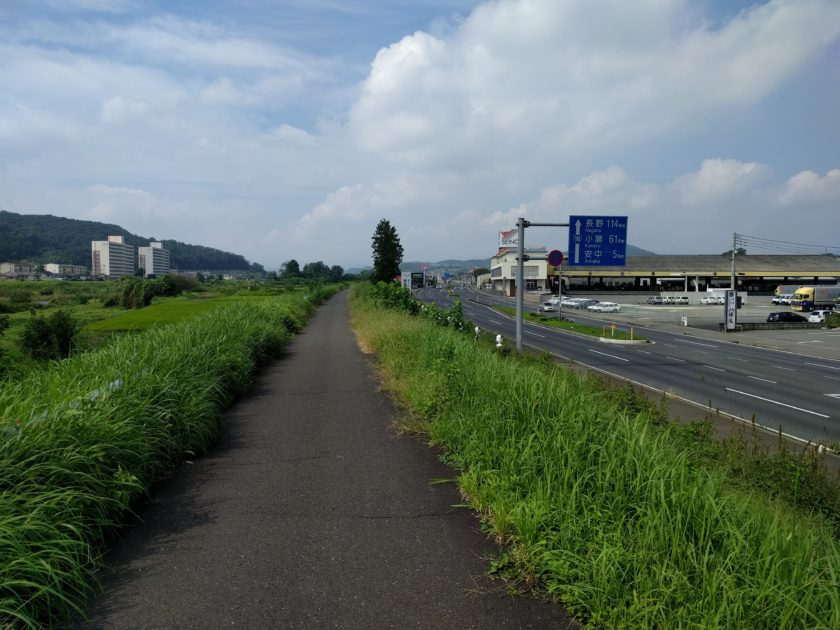 River to the left, Route 18 (and old Nakasendo, apparently) to the right. Mountains ahead, Takasaki behind.